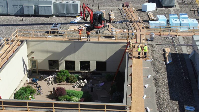 Removing machinery from River's Edge courtyard