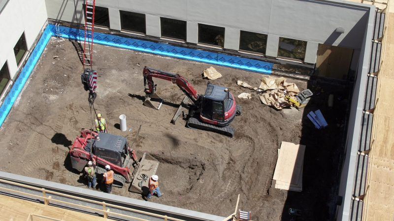 Beginning construction work on courtyard
