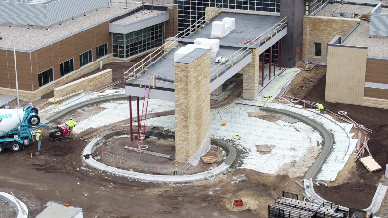 putting in the snow and ice melt system at the new main entrance.