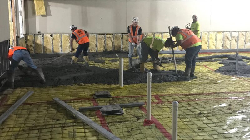 pouring concrete in former court yard