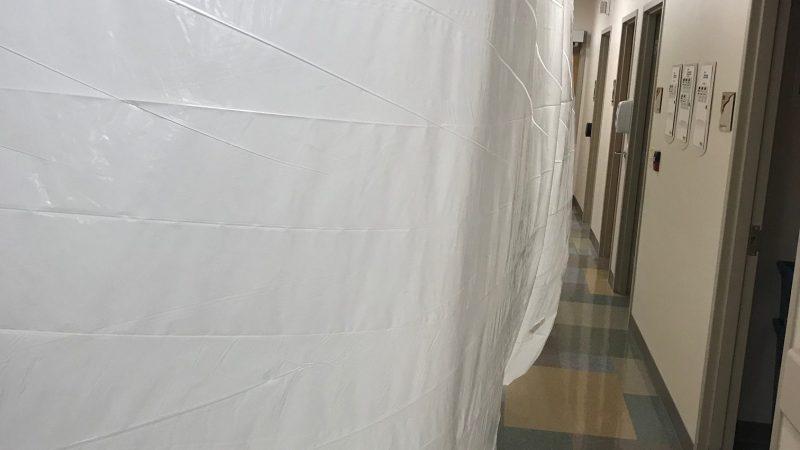 Plastic hanging in the hallway