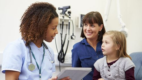 Child and parent meeting with doctor
