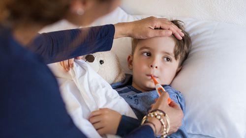 child getting temperature checked